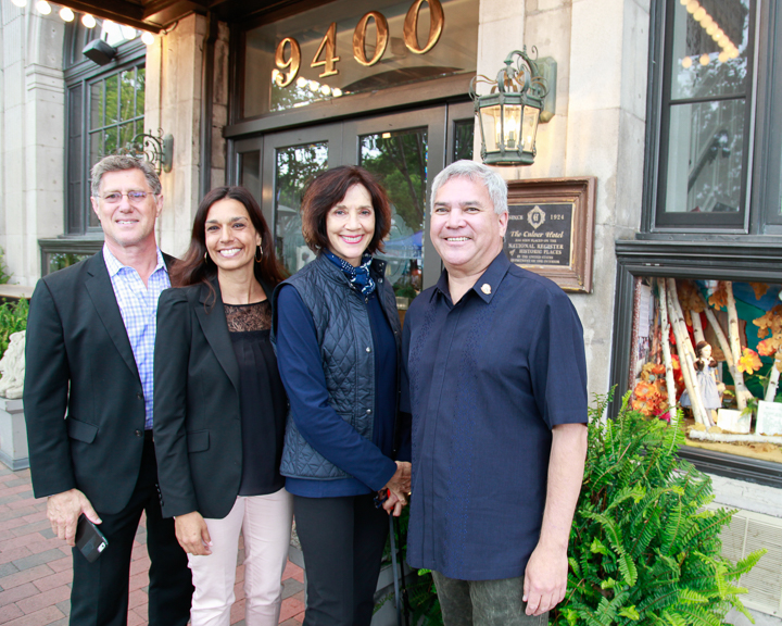 From left, Managers of the Culver Hotel pose with tour guides Nancy Griffin and Thomas Small.  Photo by Jack Prichett