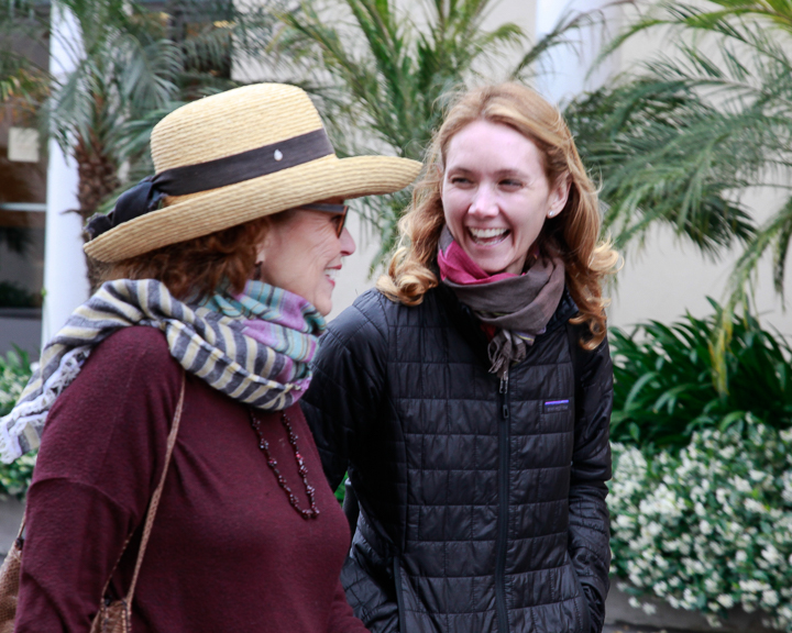 Co-chair Linda Lucks enjoys a moment with tour member, Katie.  Photo by Jack Prichett